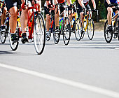 Waist  down view of racing cyclists in pack