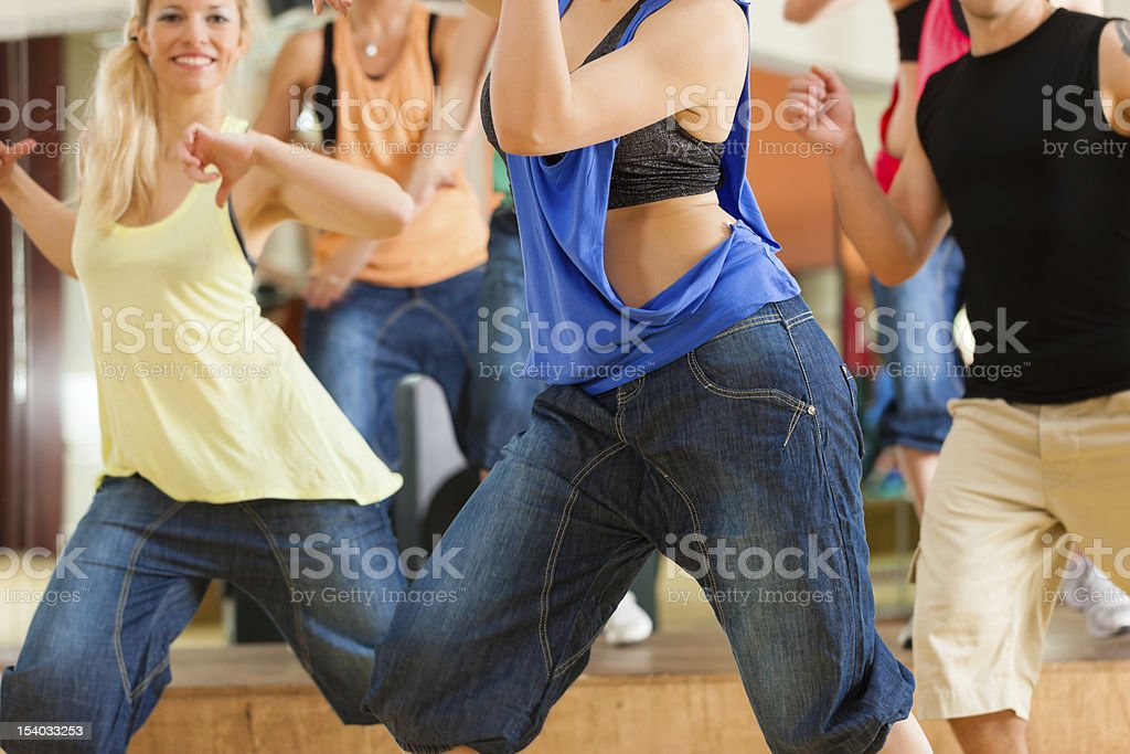 Waist shot of a group of young people dancing in a studio stock photo