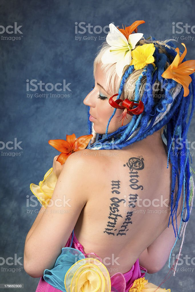 Waist up of woman with colourful outfit and flowers. royalty-free stock photo