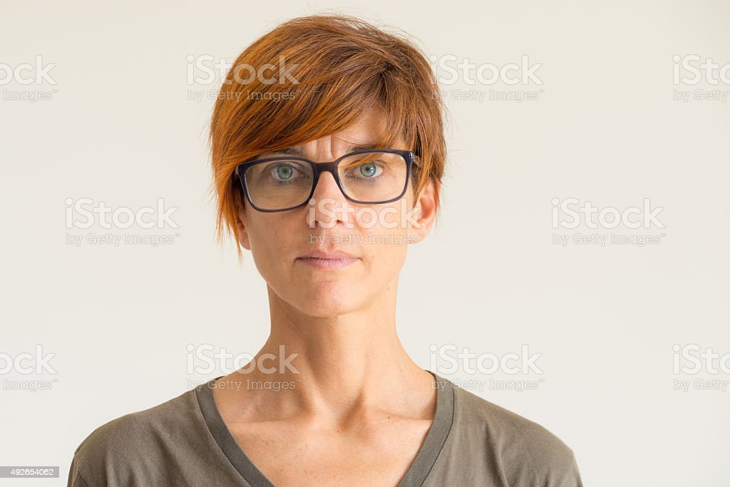 Waist up portrait of lady in neutral background stock photo