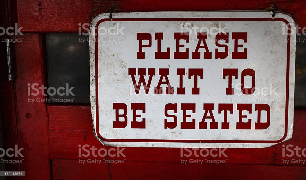 Wait to be seated sign royalty-free stock photo