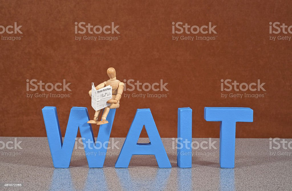 Wait - Wooden Mannequin demonstrating this word stock photo