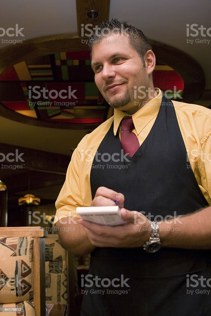 Waiter at the restaurant taking notes stock photo