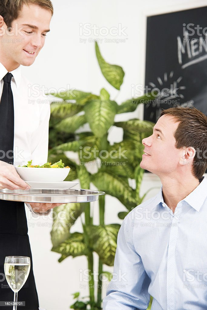 Waiter Bringing Male Customer a Salad royalty-free stock photo