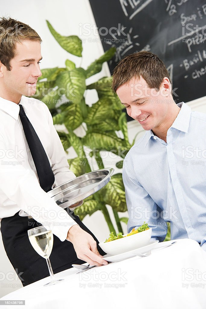 Waiter Bringing Male Customer a Salad royalty-free stock photo