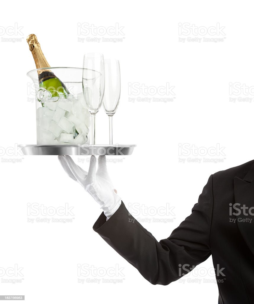 Waiter carrying a bottle of Champaigne with flutes stock photo