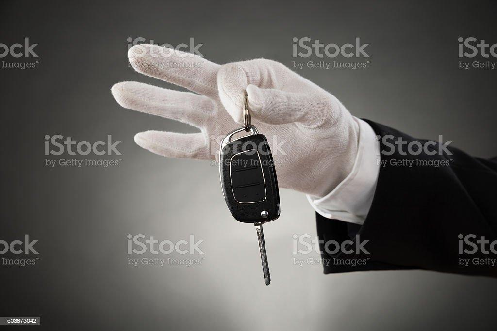 Waiter Hands Holding Car Key stock photo