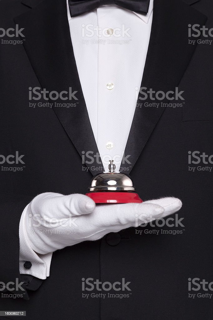 Waiter holding a service bell. stock photo