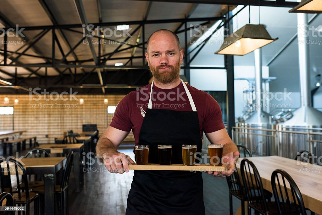 Waiter Holding A Tray Of Beer Tasting Glasses stock photo