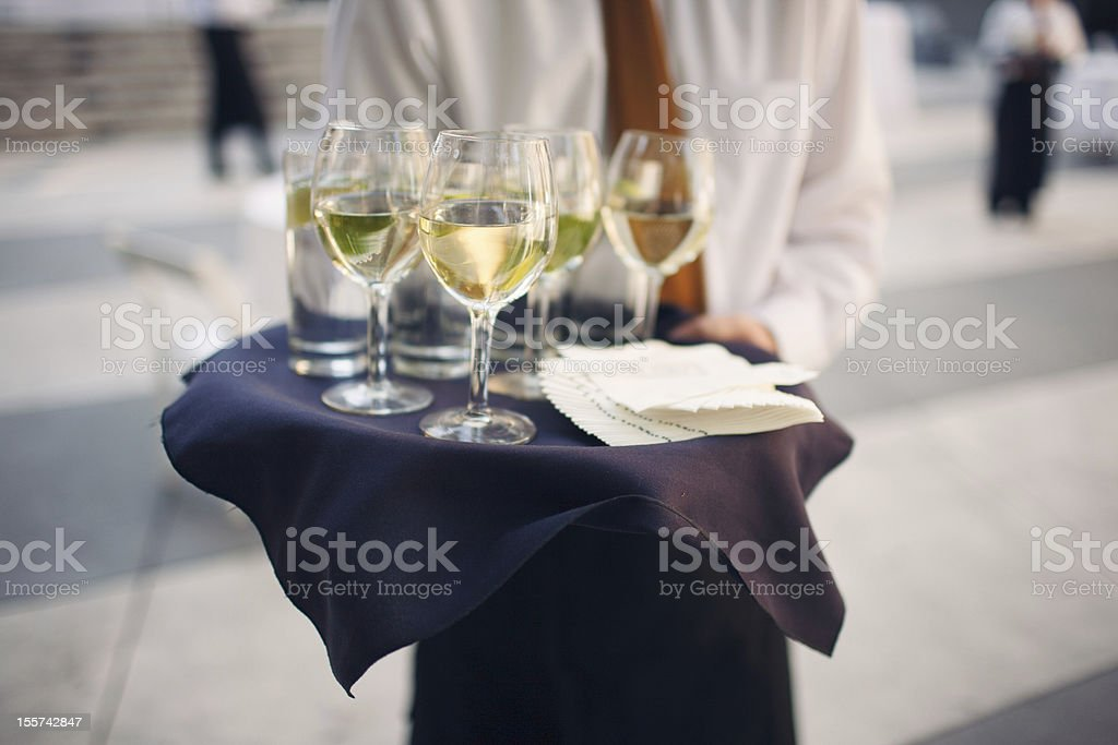 Waiter Holding a Tray of Wine Glasses stock photo