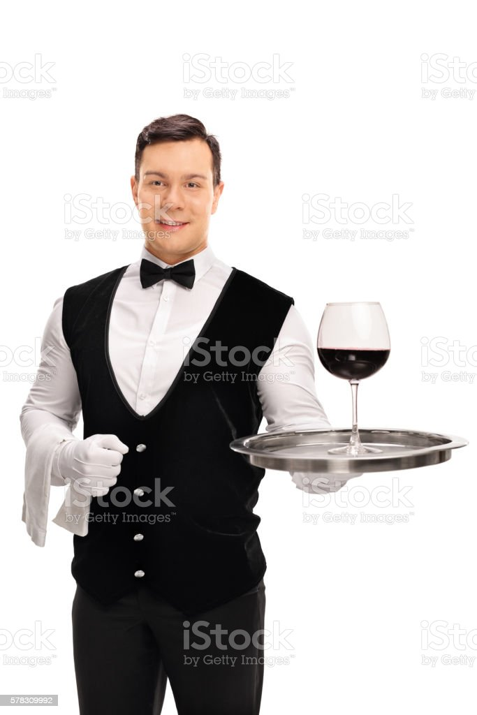 Waiter holding a tray with red wine stock photo
