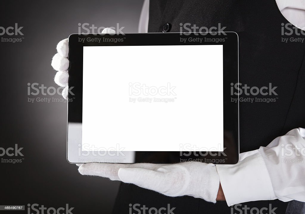 Waiter Holding Digital Tablet stock photo