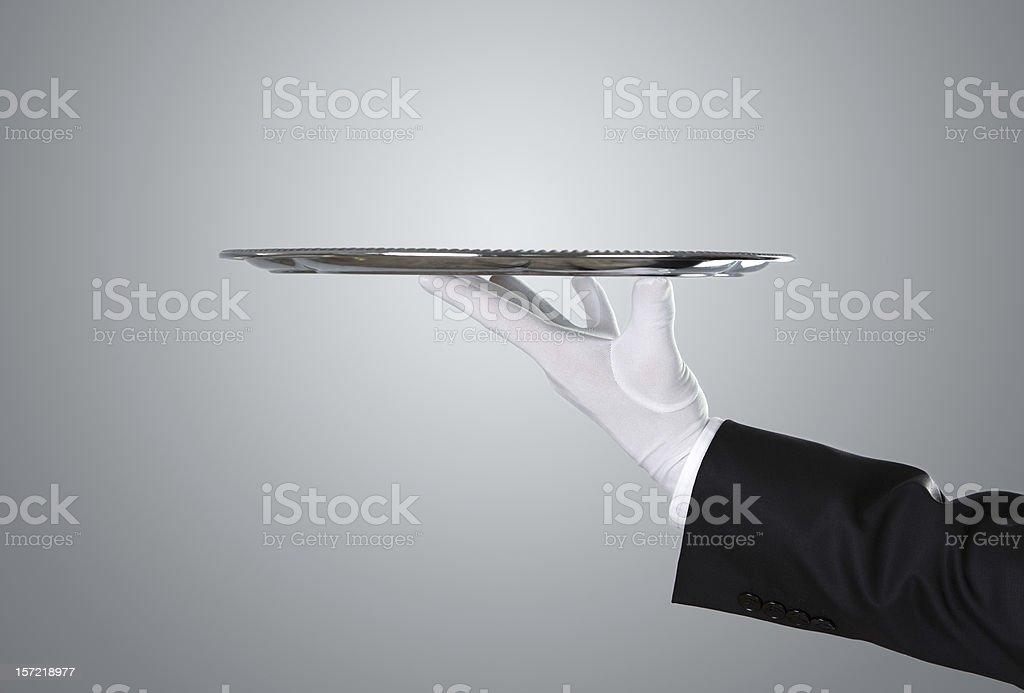 Waiter holding empty silver tray stock photo