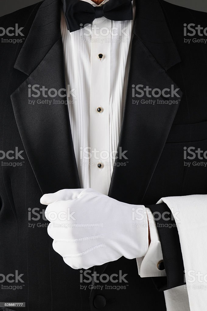 Waiter Holding Lapel stock photo