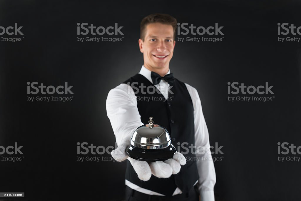 Waiter Holding Service Bell stock photo