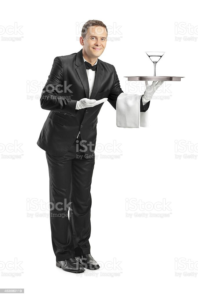 Waiter holding tray with a glass of cocktail on it stock photo