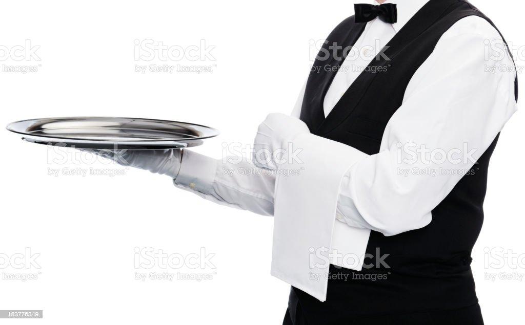 A waiter holding up an empty tray royalty-free stock photo