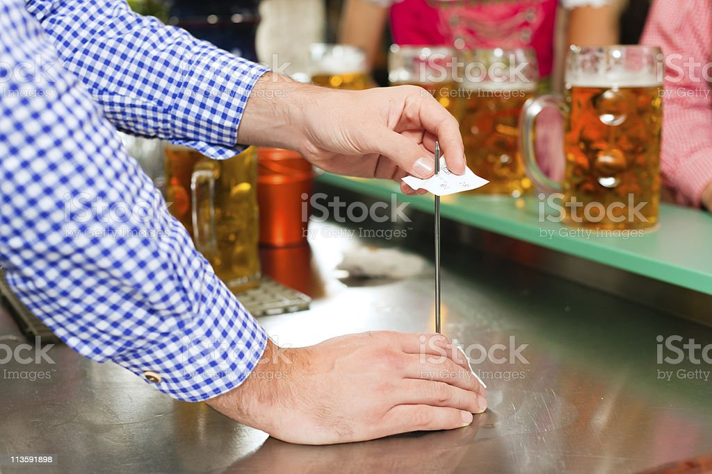 Waiter in a Bavarian pub stock photo