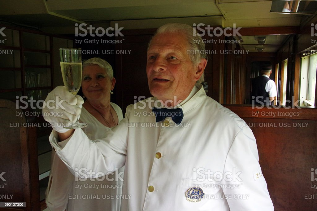 Waiter in a historical carriage stock photo