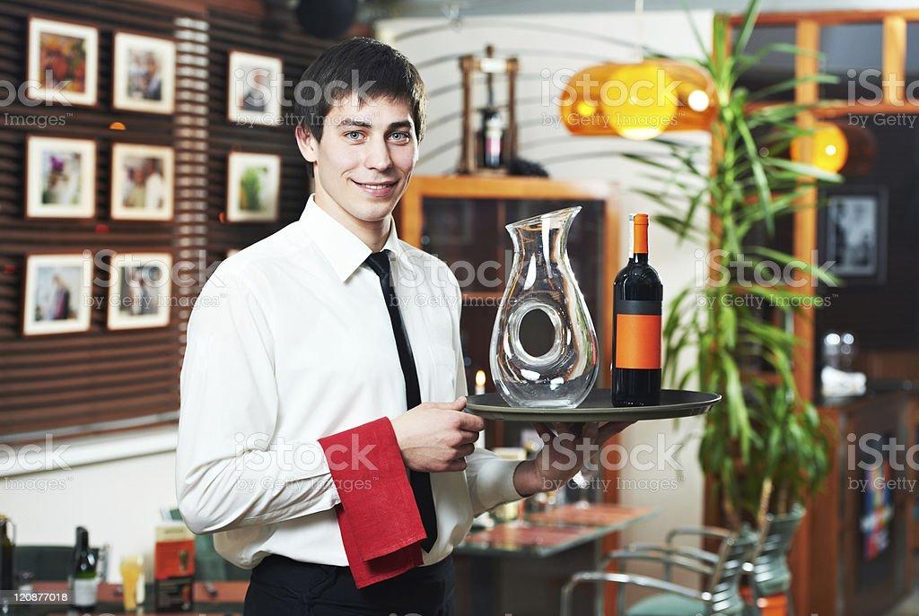 waiter in uniform at restaurant royalty-free stock photo