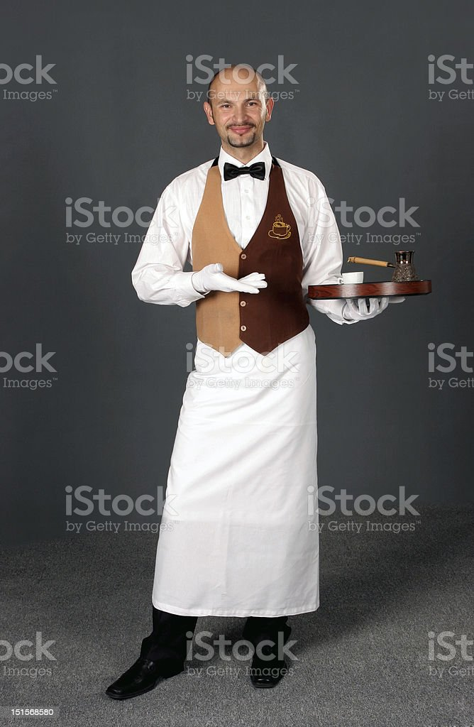 Waiter in uniform with percolator and cup of coffe royalty-free stock photo