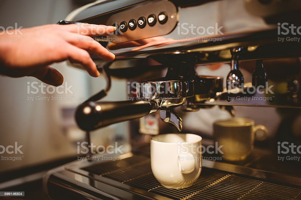 Waiter making a cup of coffee stock photo