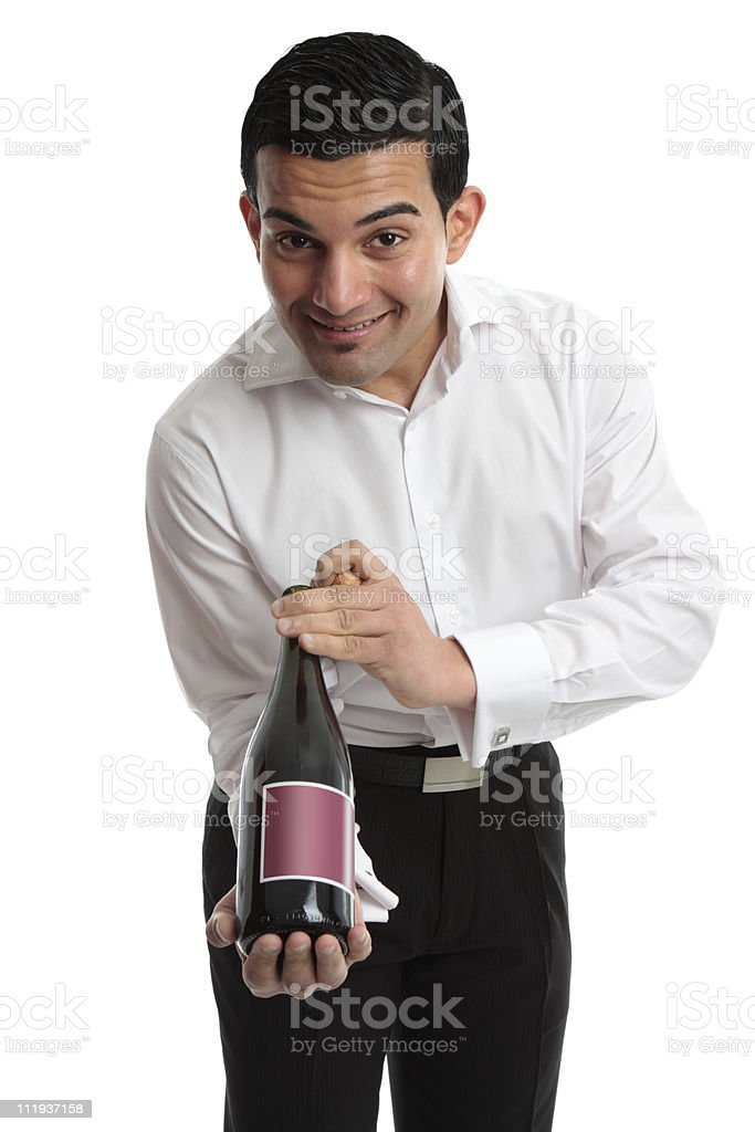 Waiter or servant presenting wine royalty-free stock photo