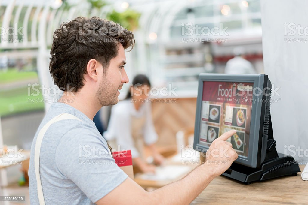 Waiter placing an order in the computer stock photo