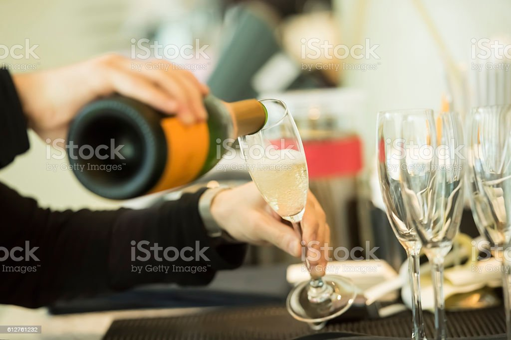 Waiter pouring champagne stock photo
