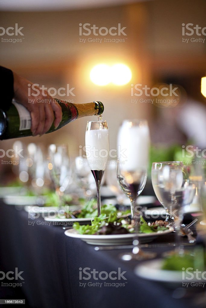 waiter pouring champaign at a wedding royalty-free stock photo