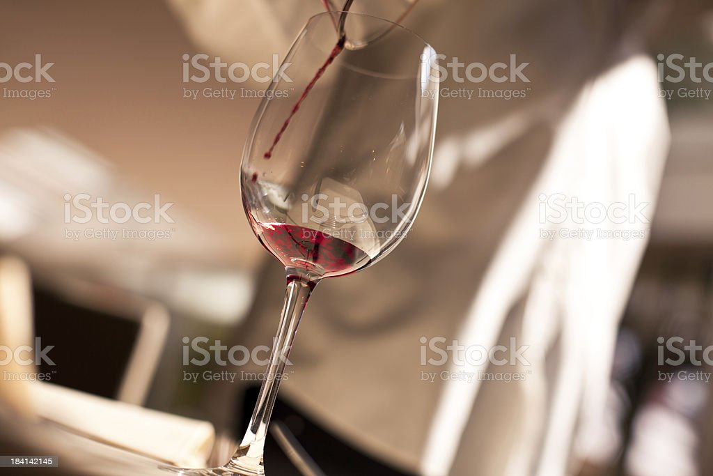 Waiter Pouring Red Wine royalty-free stock photo