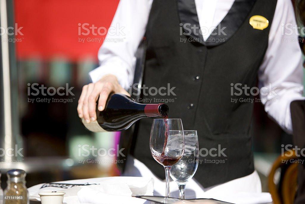 Waiter pouring wine royalty-free stock photo