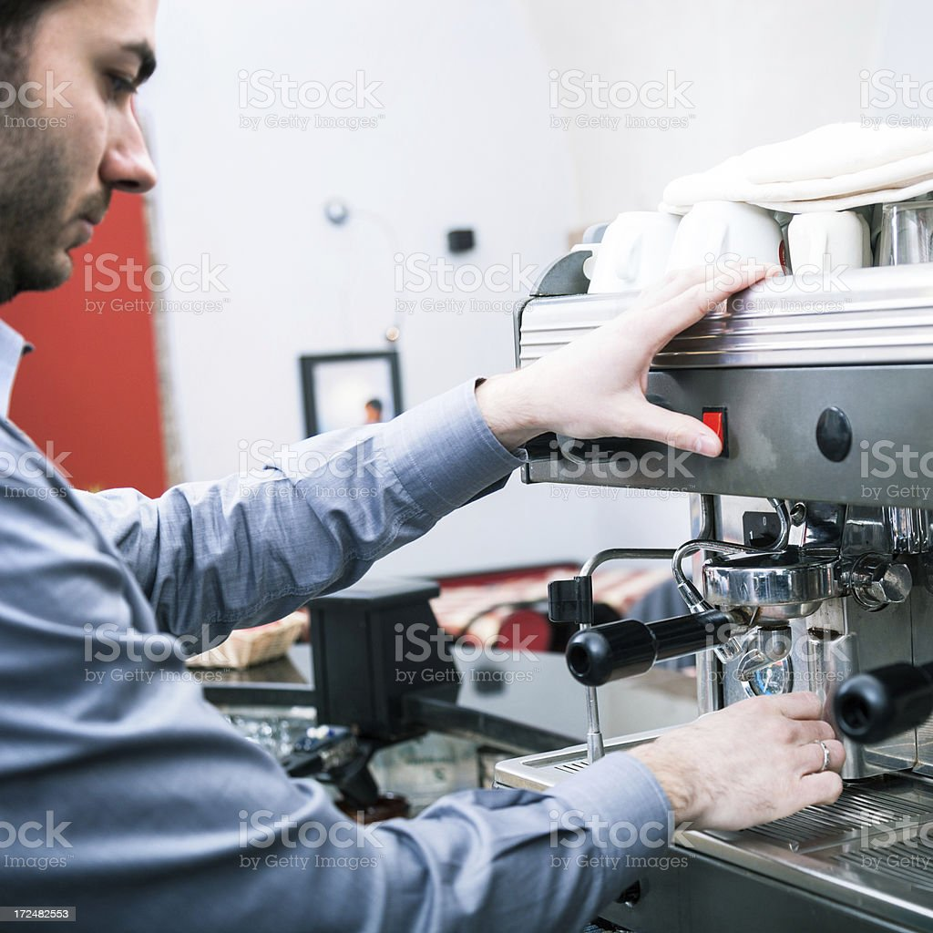 Waiter preparing coffee in a cafe royalty-free stock photo