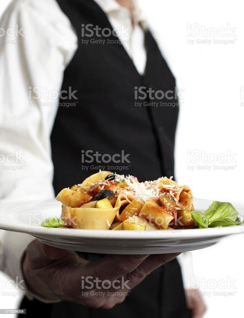 waiter serves pasta royalty-free stock photo