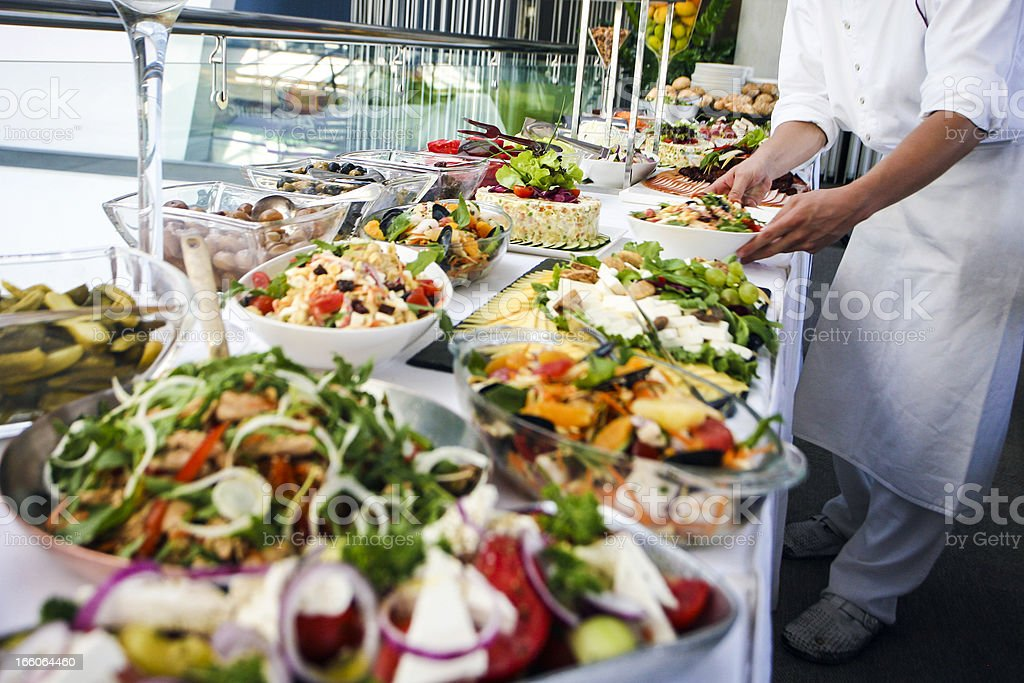 Waiter serving a buffet table stock photo