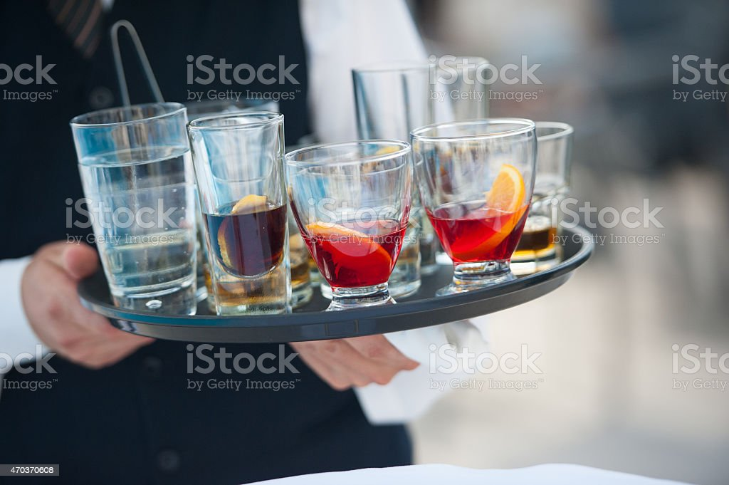 Waiter serving alcohol stock photo