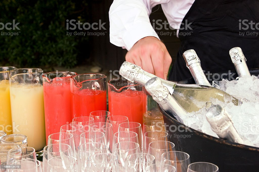 waiter serving at a party stock photo