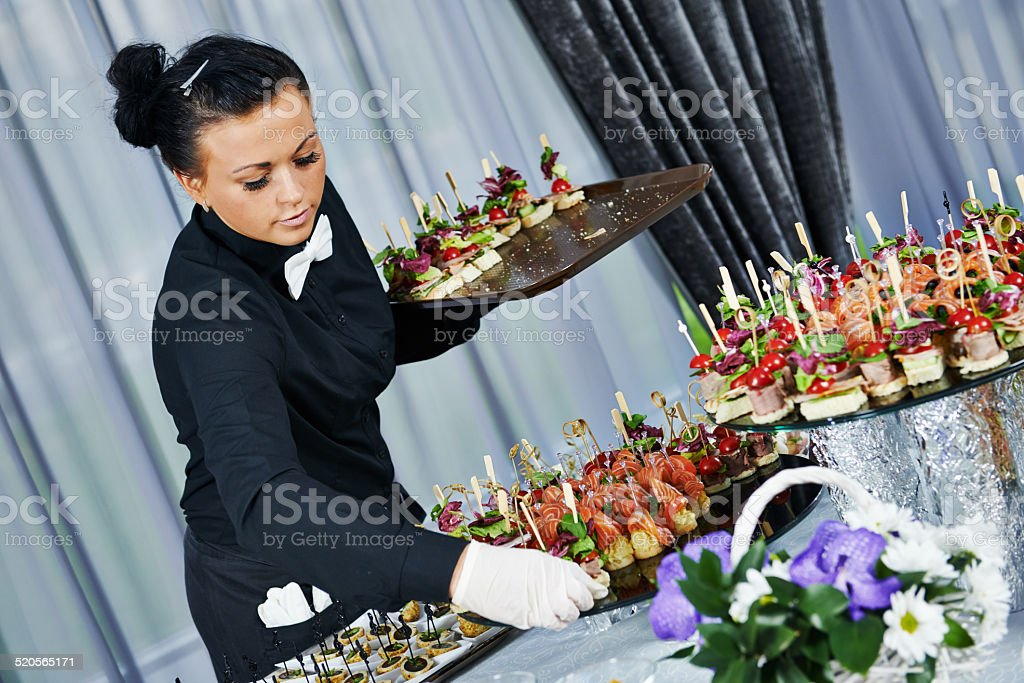 Waiter serving catering table stock photo