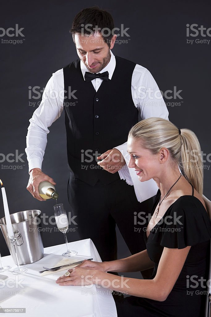 Waiter serving champagne royalty-free stock photo