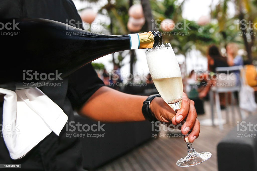 Waiter serving champagne stock photo