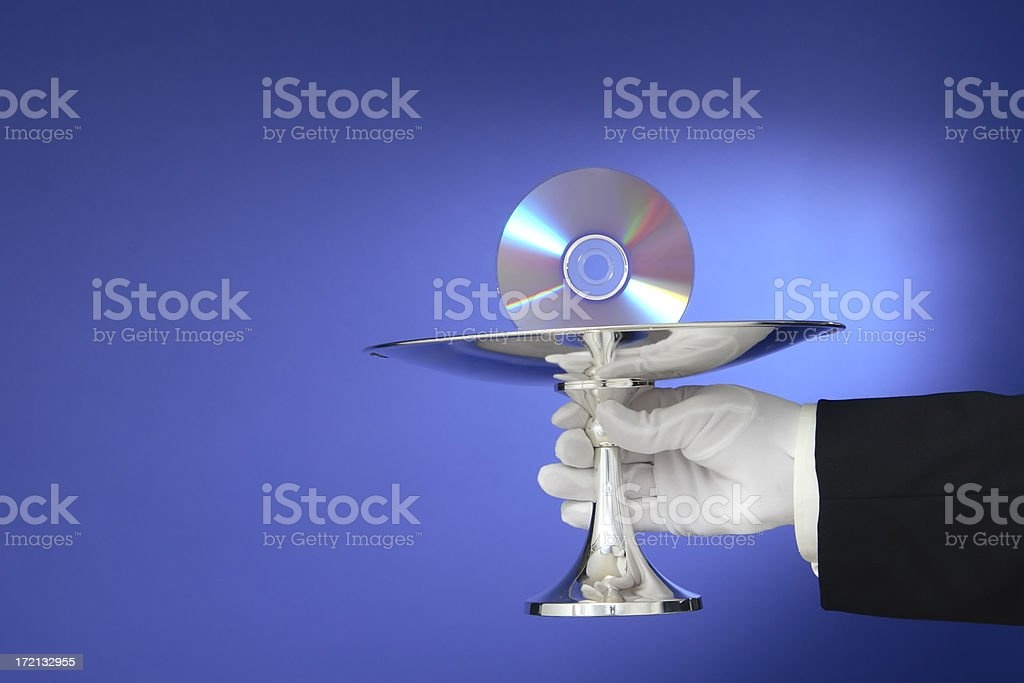 Waiter Serving Compact Disc on a Silver Platter royalty-free stock photo