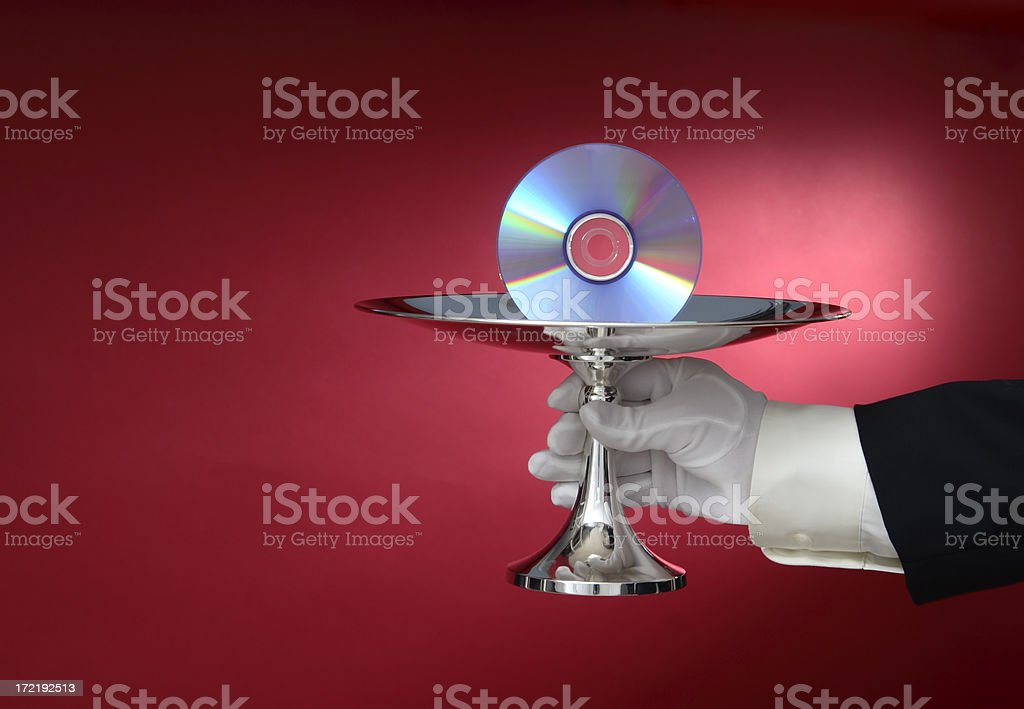Waiter Serving Compact Disc on a Silver Platter stock photo