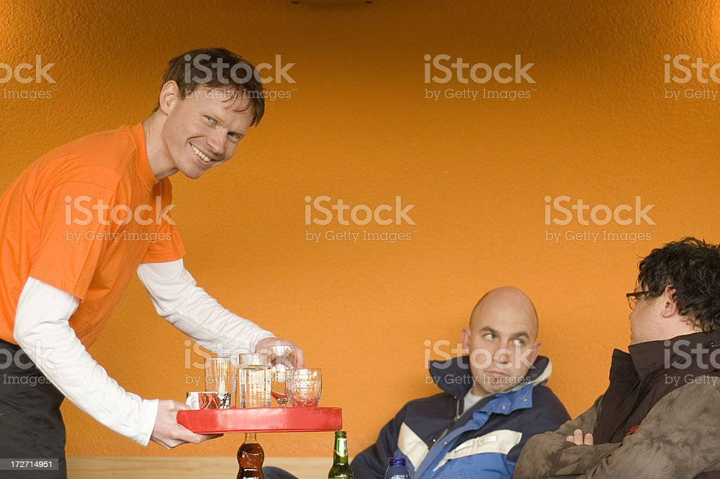 Waiter serving guests royalty-free stock photo