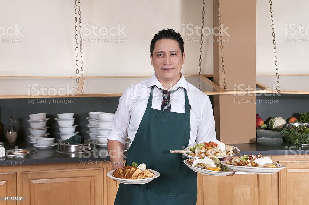 Waiter Serving Meals royalty-free stock photo
