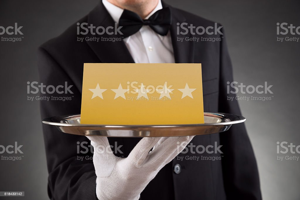 Waiter Serving Star Rating stock photo