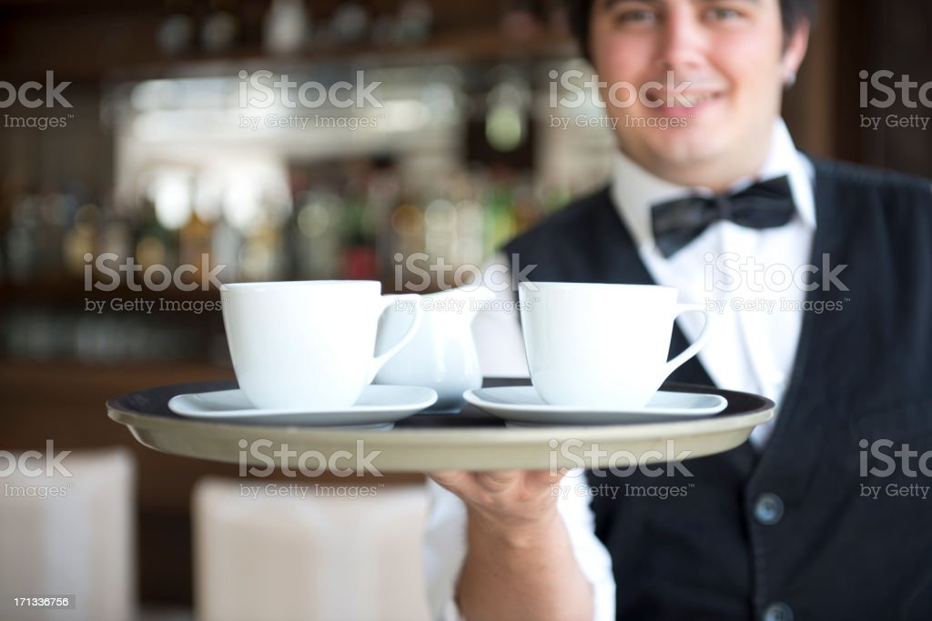 Waiter serving two cups of coffee royalty-free stock photo
