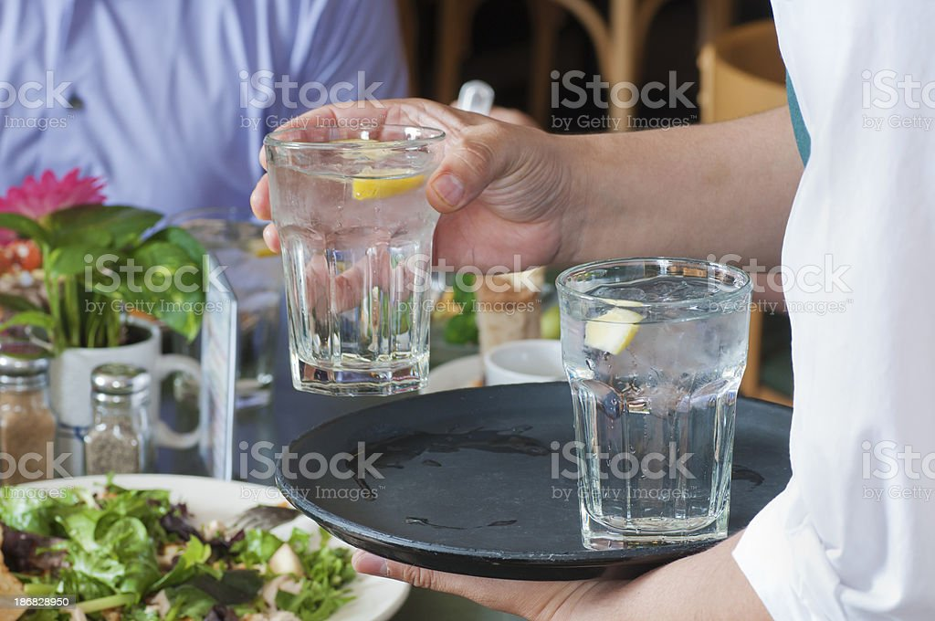 Waiter Serving Water royalty-free stock photo