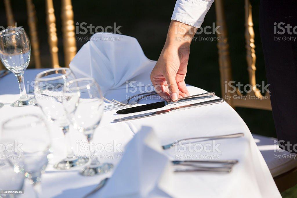 Waiter Setting The Table In Restaurant stock photo