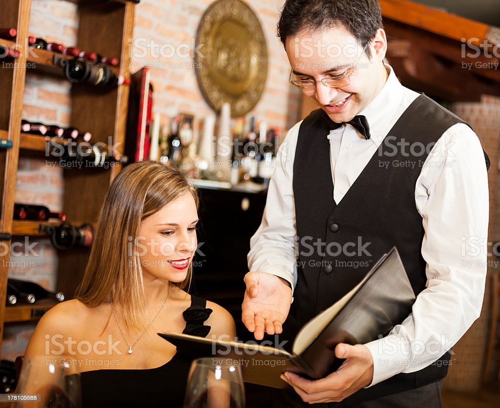 Waiter suggesting food in a restaurant royalty-free stock photo