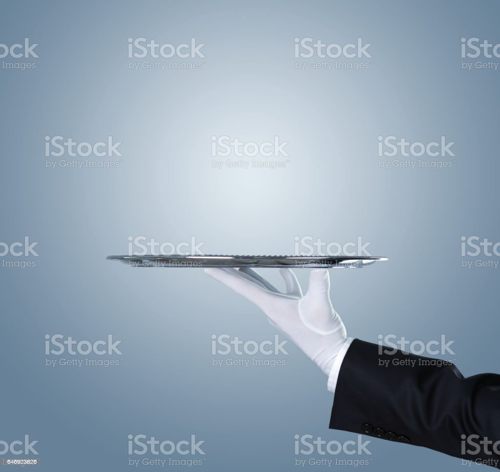 Waiter with an empty tray stock photo